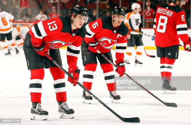 Nico Hischier of the New Jersey Devils and Andy Greene of the New Jersey Devils look on during warm ups prior to taking on the Philadelphia Flyers at...