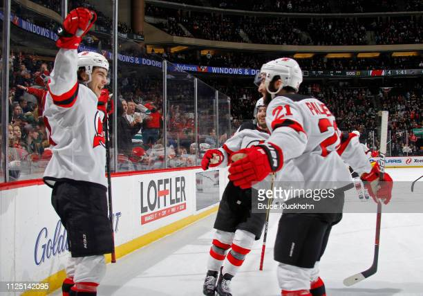Nico Hischier of the New Jersey Devils celebrates his overtime game-winning goal with Kyle Palmieri of the New Jersey Devils after a game with the...