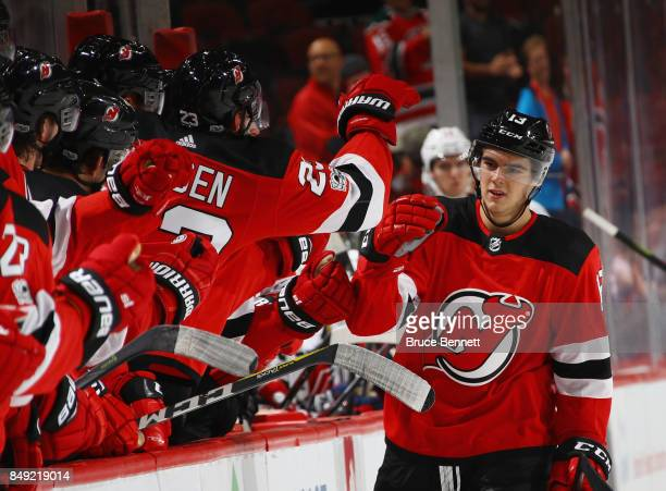 Nico Hischier of the New Jersey Devils celebrtaes his third period goal against the Washington Capitals during a preseason game at the Prudential...
