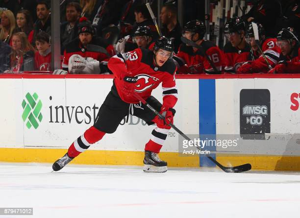 Nico Hischier of the New Jersey Devils controls the puck against the Boston Bruins during the game at Prudential Center on November 22 2017 in Newark...