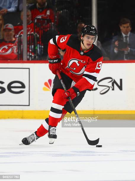 Nico Hischier of the New Jersey Devils controls the puck in Game Four of the Eastern Conference First Round against the Tampa Bay Lightning during...