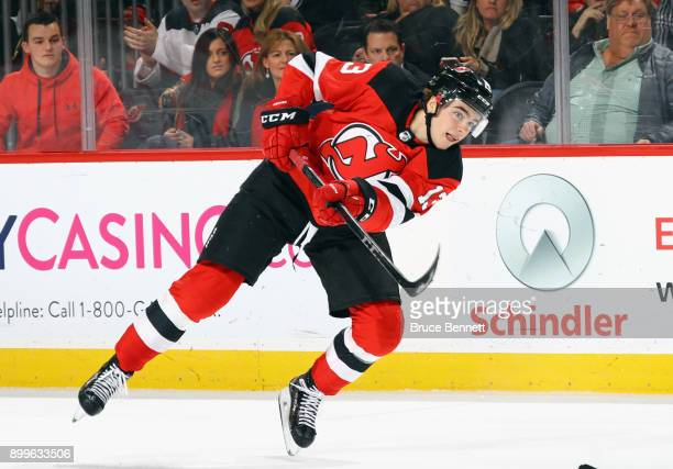 Nico Hischier of the New Jersey Devils gets off the second period shot against the Buffalo Sabres at the Prudential Center on December 29 2017 in...