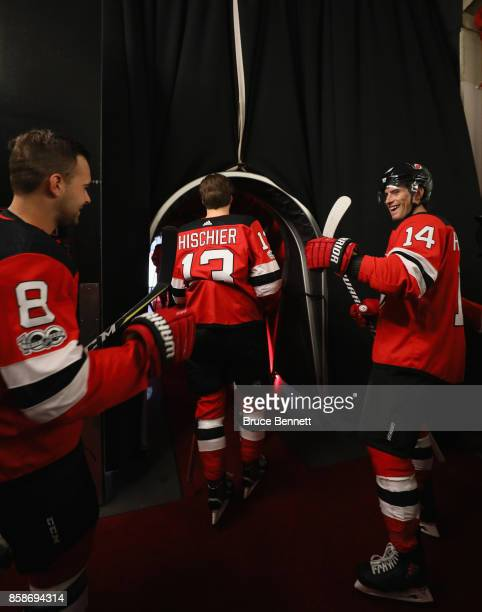 Nico Hischier of the New Jersey Devils heads out for warmups prior to his first NHL game against the Colorado Avalanche at the Prudential Center on...