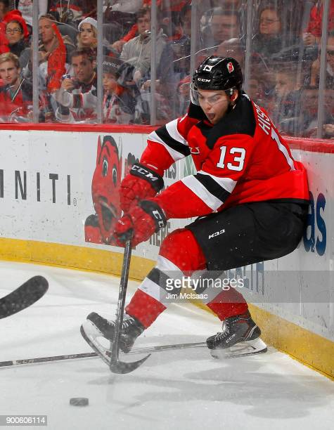 Nico Hischier of the New Jersey Devils in action against the Chicago Blackhawks on December 23 2017 at Prudential Center in Newark New Jersey The...