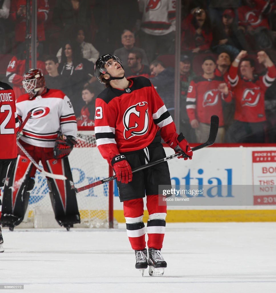Nico Hischier #13 of the New Jersey Devils looks up for the scoreboard reply after missing a third period attempt against the Carolina Hurricanes at the Prudential Center on March 27, 2018 in Newark, New Jersey. The Devils defeated the Hurricanes 4-3.
