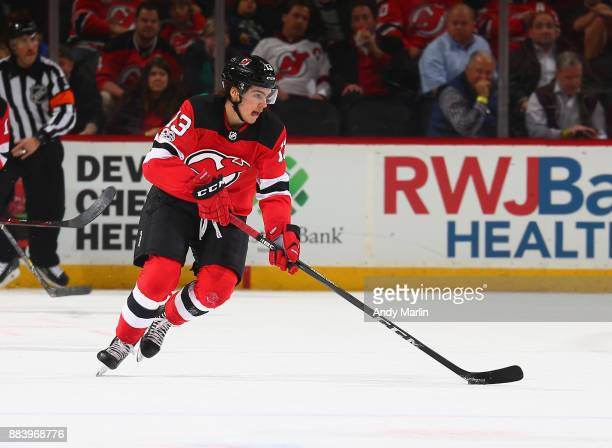 Nico Hischier of the New Jersey Devils plays the puck during the game against the Florida Panthers at Prudential Center on November 27 2017 in Newark...