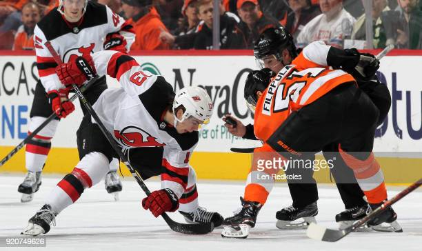 Nico Hischier of the New Jersey Devils prepares to faceoff against Valtteri Filppula of the Philadelphia Flyers on February 13 2018 at the Wells...