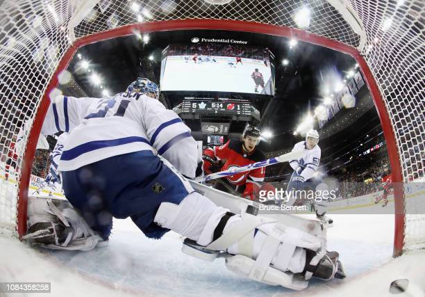Nico Hischier of the New Jersey Devils scores during the third period against Frederik Andersen of the Toronto Maple Leafs at the Prudential Center...