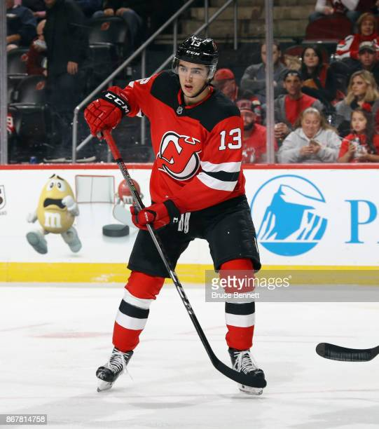 Nico Hischier of the New Jersey Devils skates against the Arizona Coyotes at the Prudential Center on October 28 2017 in Newark New Jersey The Devils...
