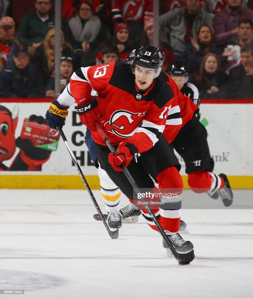 Nico Hischier #13 of the New Jersey Devils skates against the Buffalo Sabres at the Prudential Center on December 29, 2017 in Newark, New Jersey. The Sabres defeated the Devils 4-3 in overtime.