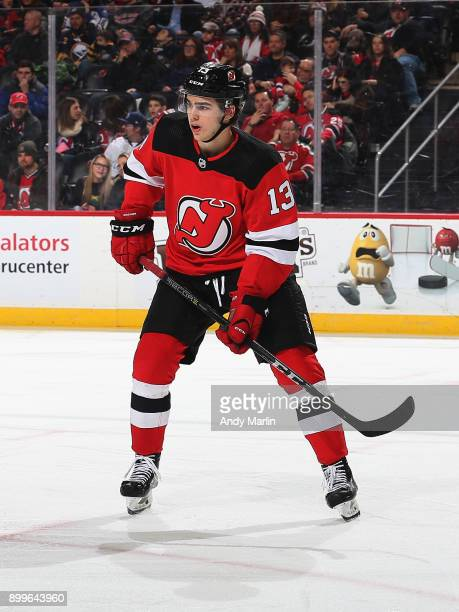 Nico Hischier of the New Jersey Devils skates against the Buffalo Sabres during the game at Prudential Center on December 29 2017 in Newark New Jersey