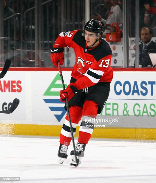 Nico Hischier of the New Jersey Devils skates against the Columbus Blue Jackets at the Prudential Center on December 8 2017 in Newark New Jersey The...