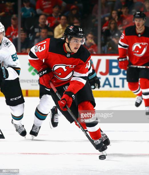 Nico Hischier of the New Jersey Devils skates against the San Jose Sharks at the Prudential Center on October 20 2017 in Newark New Jersey The Sharks...