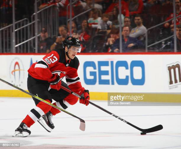 Nico Hischier of the New Jersey Devils skates in his first NHL game against the Colorado Avalanche at the Prudential Center on October 7 2017 in...