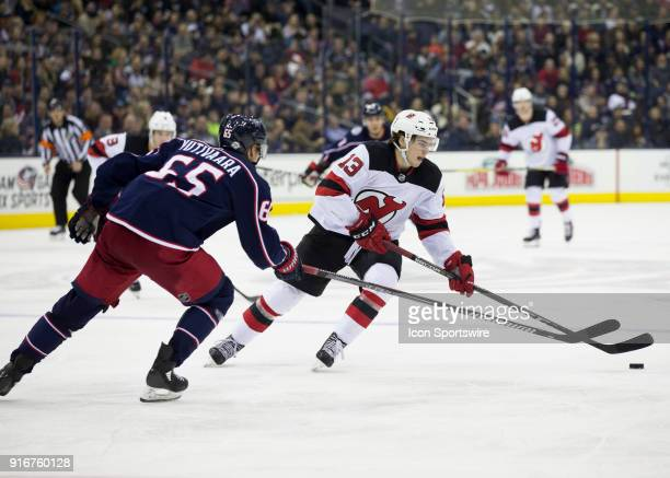 Nico Hischier of the New Jersey Devils skates with the puck during the third period of the game between the Columbus Blue Jackets and the New Jersey...