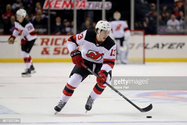 Nico Hischier of the New Jersey Devils skates with the puck in the first period against the New York Islanders during their game at Barclays Center...
