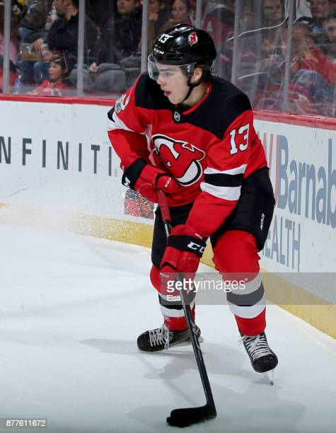 Nico Hischier of the New Jersey Devils takes the puck in the second period against the Boston Bruins on November 22 2017 at Prudential Center in...