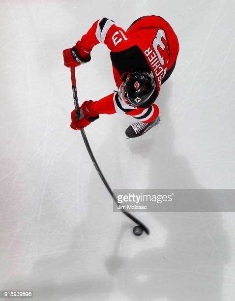 Nico Hischier of the New Jersey Devils warms up before a game against the Calgary Flames on February 8 2018 at Prudential Center in Newark New Jersey