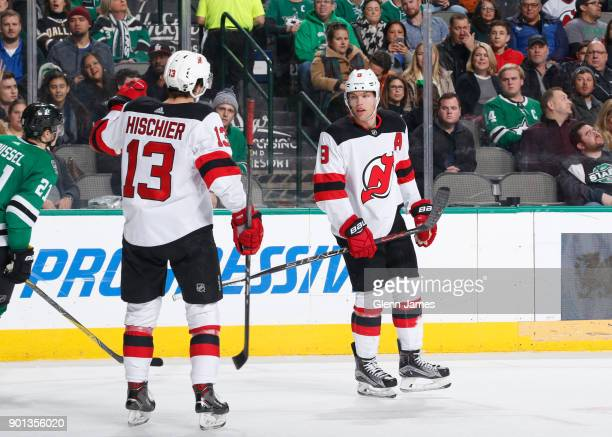 Nico Hischier Taylor Hall and the New Jersey Devils celebrate a goal against the Dallas Stars at the American Airlines Center on January 4 2018 in...