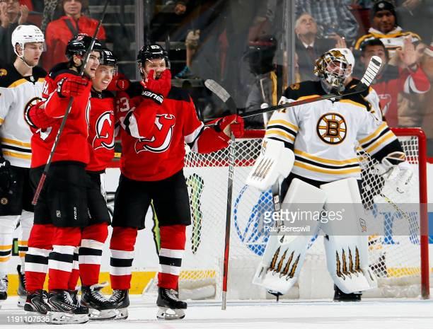 Nico HischierNikita Gusev Jesper Bratt of the New Jersey Devils celebrate a goal by Bratt to tie the game as goalie Jaroslav Halak of the Boston...