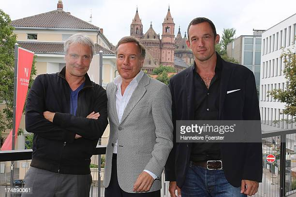 Nico Hofmann the new Director from 2015 at the Nibelungen festival Thomas Schadt and Albert Ostermaier Author pose during a press conference on July...