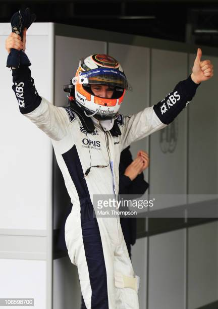Nico Huelkenberg of Germany and Williams celebrates in parc ferme after finishing first during qualifying for the Brazilian Formula One Grand Prix at...