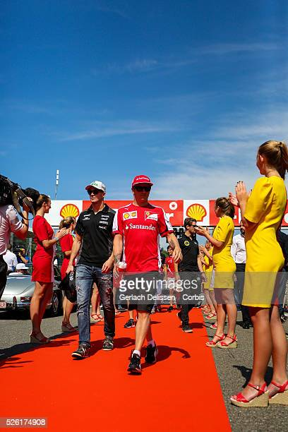 Nico Huldenberg driving for the Sahara Force India F1 Team and Kimi Raikkonen driving for the Scuderia Ferrari Team at the drivers parade during the...
