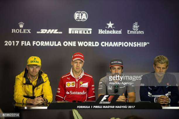 Nico Hulkenber of Germany Sebastian Vettel of Germany and Ferrari Fernando Alonso of Spain and Marcus Ericsson of Sweden and Sauber talk in the...