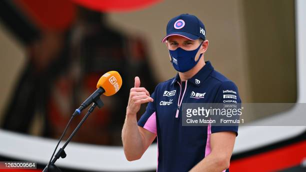 Nico Hulkenberg of Germany and Racing Point talks to the media in the Paddock after practice for the F1 Grand Prix of Great Britain at Silverstone on...