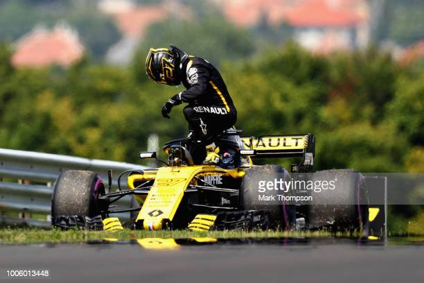 Nico Hulkenberg of Germany and Renault Sport F1 climbs from his car after stopping on track during practice for the Formula One Grand Prix of Hungary...
