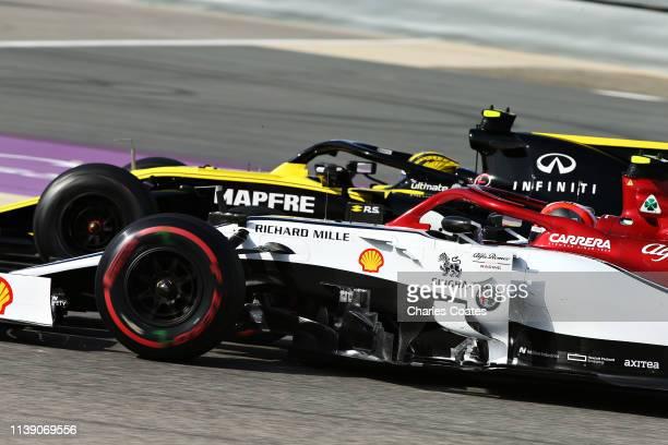 Nico Hulkenberg of Germany driving the Renault Sport Formula One Team RS19 and Antonio Giovinazzi of Italy driving the Alfa Romeo Racing C38 Ferrari...