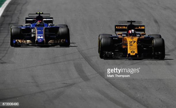 Nico Hulkenberg of Germany driving the Renault Sport Formula One Team Renault RS17 overtakes Pascal Wehrlein of Germany driving the Sauber F1 Team...