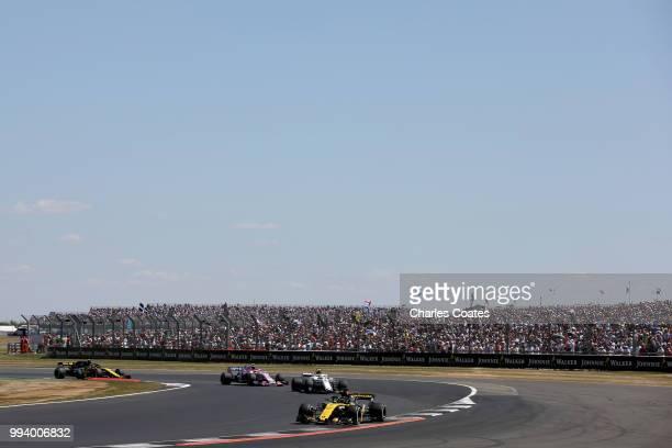 Nico Hulkenberg of Germany driving the Renault Sport Formula One Team RS18 leads Charles Leclerc of Monaco driving the Alfa Romeo Sauber F1 Team C37...