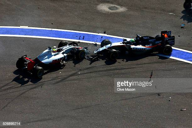 Nico Hulkenberg of Germany driving the Sahara Force India F1 Team VJM09 Mercedes PU106C Hybrid turbo and Esteban Gutierrez of Mexico driving the Haas...