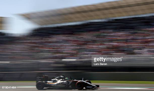 Nico Hulkenberg of Germany driving the Sahara Force India F1 Team VJM09 Mercedes PU106C Hybrid turbo waves to the crowd during qualifying for the...