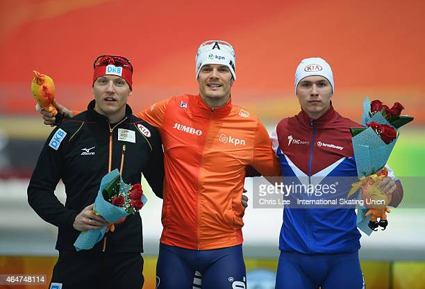 Nico Ihle of Germany Hein Otterspeer of Netherlands and Pavel Kulizhnikov of Russia pose for the camera's after their podium finish in the Mens 1000m...