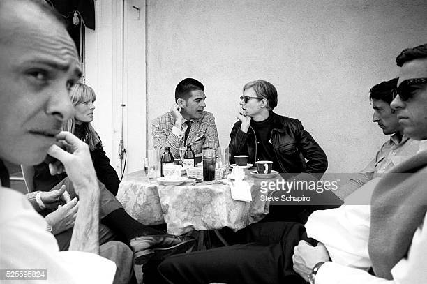 Nico, Irving Blum, Ed Ruscha and others having lunch with Andy Warhol in Los Angeles