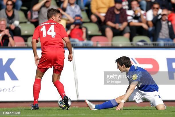 Nico Klass of RW Oberhausen and Benito Raman of FC Schalke 04 battle for the ball during the preseason friendly match between RW Oberhausen and...
