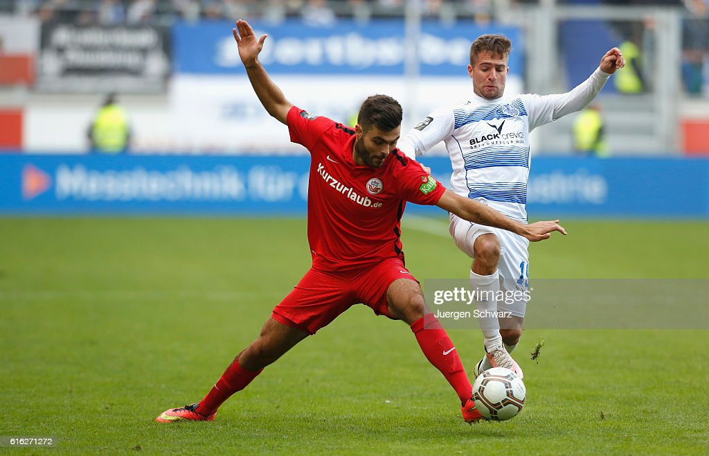 Nico Klotz of Duisburg (R) tackles Kerem Buelbuel of Rostock during the third league match between MSV Duisburg and Hansa Rostock at Schauinsland-Reisen-Arena on October 22, 2016 in Duisburg, Germany.