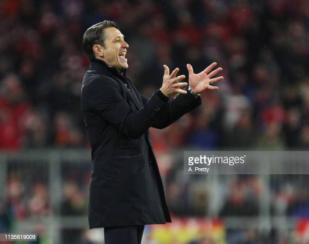 Nico Kovac head coach of Bayern Muenchen gives instructions during the UEFA Champions League Round of 16 Second Leg match between FC Bayern Muenchen...