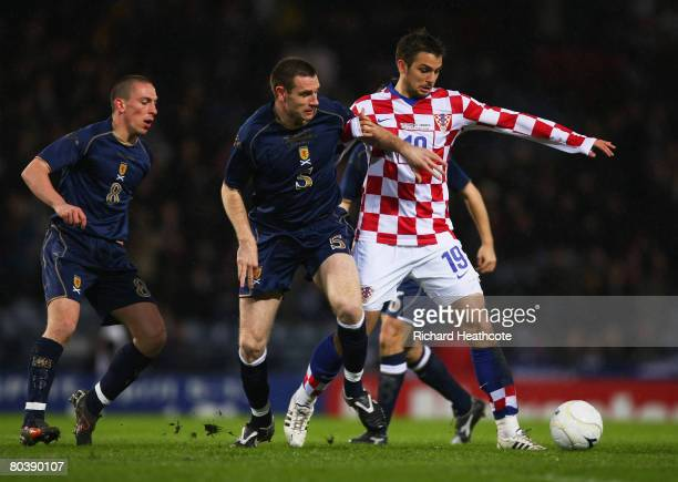 Nico Kranjcar of Croatia holds off the challenge from Stephen McManus of Scotland during the Tennent's International Challenge friendly match between...