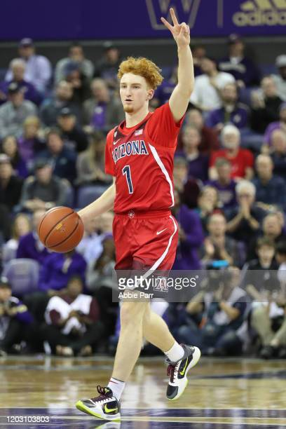 Nico Mannion of the Arizona Wildcats dribbles with the ball in the second half against the Washington Huskies during their game during their game at...