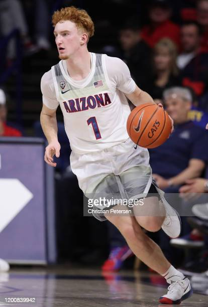 Nico Mannion of the Arizona Wildcats handles the ball against the Utah Utes during the second half of the NCAAB game at McKale Center on January 16,...