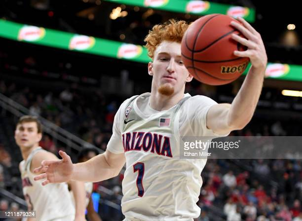 Nico Mannion of the Arizona Wildcats intercepts a Washington Huskies pass during the first round of the Pac-12 Conference basketball tournament at...
