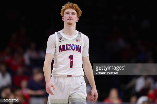 Nico Mannion of the Arizona Wildcats reacts as he walks down court during the second half of the NCAAB game against the Utah Utes at McKale Center on...