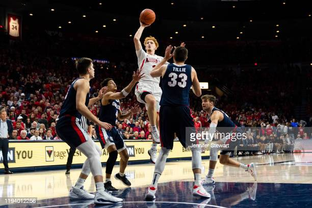 Nico Mannion of the Arizona Wildcats shoots the ball over Gonzaga Bulldogs defenders in the first half at McKale Center on December 14, 2019 in...