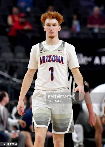 Nico Mannion of the Arizona Wildcats stands on the court during a first-round game of the Pac-12 Conference basketball tournament against the...