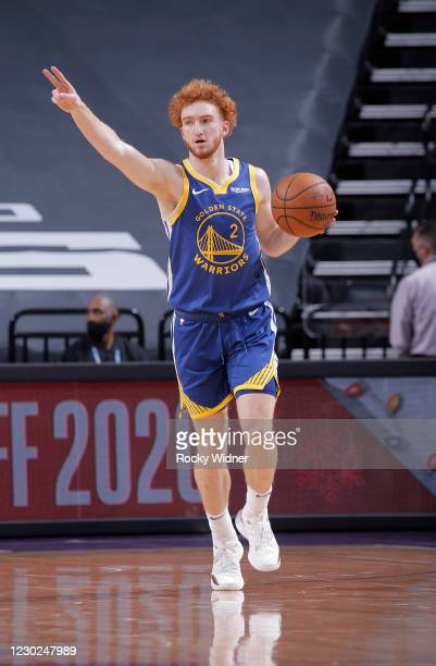 Nico Mannion of the Golden State Warriors brings the ball up the court against the Sacramento Kings on December 17, 2020 at Golden 1 Center in...