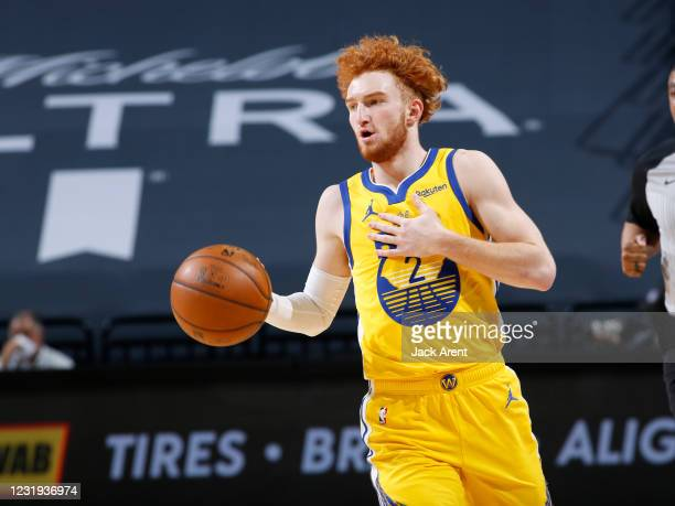 Nico Mannion of the Golden State Warriors brings the ball up the court against the Sacramento Kings on March 25, 2021 at Golden 1 Center in...
