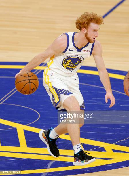 Nico Mannion of the Golden State Warriors dribbles against the Denver Nuggets during their NBA preseason game at Chase Center on December 12, 2020 in...